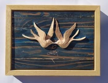 image de Cadeau en bois sculpté