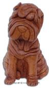 sculpture sur bois d'un chiot Shar pei